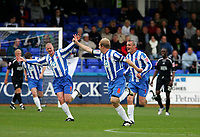 Photo: Andrew Unwin.<br />Hartlepool Utd v Swansea. Coca Cola League 1.<br />17/09/2005.<br />Hartlepool's Ritchie Humphreys  (C) leads the celebrations after scoring for his team.