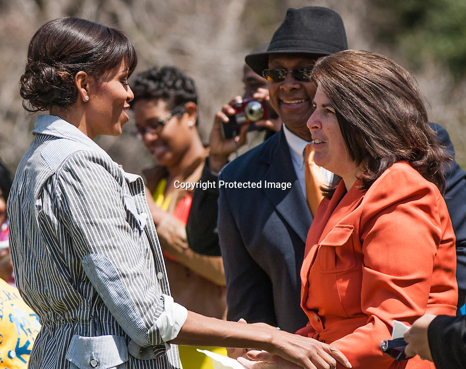 (L-R)First Lady Michelle Obama and Tanna Nicely, assistant principal of Sarah Moore Greene Magnet Technology Academy School, Knox County, TN speak  during an event where Nicely's  students and the First  Lady planted the White House Kitchen Garden for the fifth year in a row at the White House on April 4, 2013 in Washington DC. Photo by Kris Connor