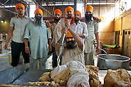 A team of men employed to prepare the dough used for chapati. A mixture of wheat, water and a hint of oil.
