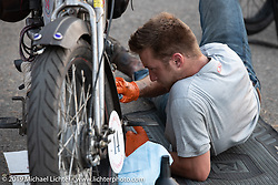 Loring Hill working on his Henderson during the Motorcycle Cannonball coast to coast vintage run. Stage 8 (314 miles) from Spirit Lake, IA to Pierre, SD. Saturday September 15, 2018. Photography ©2018 Michael Lichter.