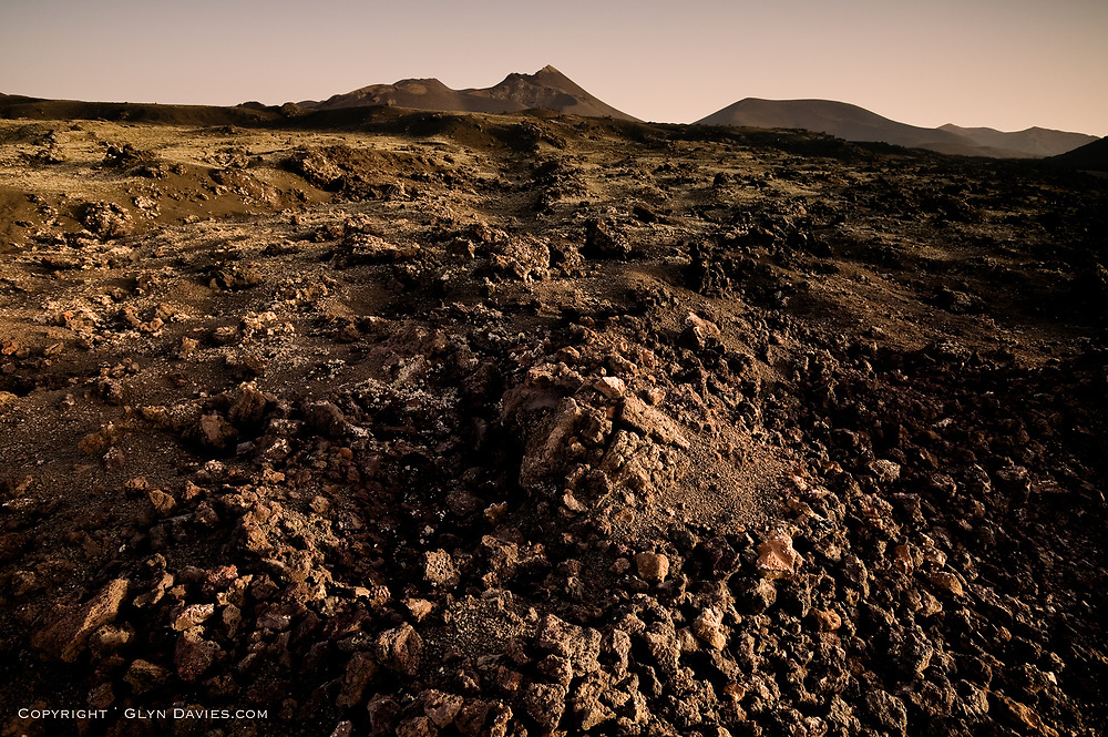 Ash rock & pyroclastic materials exploded out of the volcanoes of Timanfaya in Lanzarote. This region was used for testing of lunar vehicles because of it's similarity to the surface of the moon.