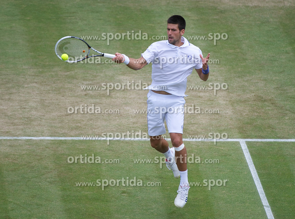 29.06.2011, Wimbledon, London, GBR, ATP World Tour, Wimbledon Tennis Championships, im Bild Novak Djokovic (SRB) in action during the Gentlemen's Singles Quarter-Final match on day nine of the Wimbledon Lawn Tennis Championships at the All England Lawn Tennis and Croquet Club. EXPA Pictures © 2011, PhotoCredit: EXPA/ Propaganda/ David Rawcliffe +++++ ATTENTION - OUT OF ENGLAND/UK +++++