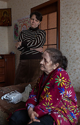 Lina and her mother live in a small apartment with Lina's two young daughters and her husband. They try to care for Lydia who suffers from Parkinson's disease. Due to the recent conflict and the Ukranian government's halting of pension payments to residents in the town they are unable to afford the necessary drugs. <br /> Lydia would normally draw a pension of K1300  but the drugs she needs cost K2600 for each box and the family has asked relatives in Italy to help them. Doctors from MSF would like to prescribe a new drug but are unsure if she will be able to mainatin the regime to make it effective since there is no availability of these medecines except from humanitarian donations which may not be reliable in the long term.