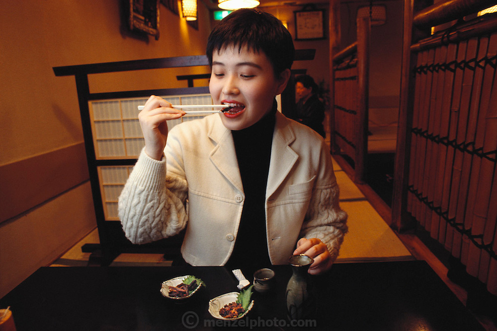 In a basement sushi bar in Tokyo, Japan, Mariko Urabe prepares to eat an inago, a grasshopper. She had never eaten one before and wasn't particularly interested in eating this one. The second small bowl of appetizers contains silkworm pupae. As is true in many countries, food preferences are culturally based and don't necessarily extend to the entire country. (Man Eating Bugs: The Art and Science of Eating Insects)