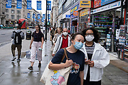 Face masks under coronavirus lockdown on Oxford Street on 1st July 2020 in London, England, United Kingdom. As the July deadline approaces and government will relax its lockdown rules further, the central London remains very quiet, while some non-essential shops are allowed to open with individual shops setting up social distancing systems.