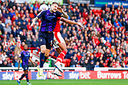 Luton Town defender Sonny Bradley (5) challenges with Barnsley forward Jacob Brown (33)  during the EFL Sky Bet League 1 match between Barnsley and Luton Town at Oakwell, Barnsley, England on 13 October 2018.