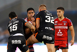 Salford Red Devils' Lama Tase (centre) is tackled by Castleford Tigers' Jesse Sene-Lefao (left) and Liam Watts during the Betfred Super League match at the AJ Bell Stadium, Salford.