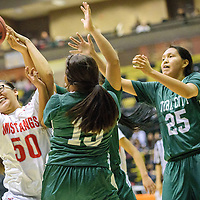 021015  Adron Gardner/Independent<br /> <br /> Monument Valley Mustang Nizhoni Whitehorse (50), left, pulls down a rebound in Chinle Tuesday.