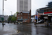 Housing estate tower blocks at Holloway Circus in Birmingham city centre, which is virtually deserted under Coronavirus lockdown on a wet rainy afternoon on 28th April 2020 in Birmingham, England, United Kingdom. Britains second city has been in a state of redevelopment for some years now, but with many outdated architectural remnants still remaining, on a grey day, the urban landscape appears as if frozen in time. Coronavirus or Covid-19 is a new respiratory illness that has not previously been seen in humans. While much or Europe has been placed into lockdown, the UK government has put in place more stringent rules as part of their long term strategy, and in particular social distancing.