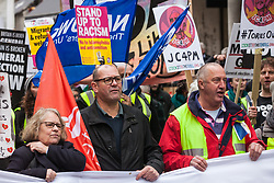 London, UK. 12th January, 2019. Lindsey German (l) and Steve Turner (c) of the People's Assembly Against Austerity are joined by Erick Simon (r) of the French 'gilets jaunes' on the 'Britain is Broken: General Election Now' demonstration. Organisers argued that the overriding objective of working people in the UK should be to remove the Conservative Government from power through a general election regardless of their vote in the EU referendum.