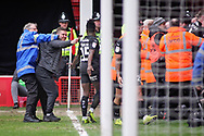 A Barnsley fan is escorted off the ground by a steward after the Barnsley goal during the EFL Sky Bet League 1 match between Walsall and Barnsley at the Banks's Stadium, Walsall, England on 23 March 2019.