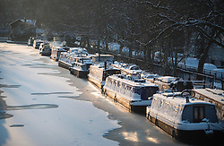 © Licensed to London News Pictures. 28/02/2018. London, UK. Picturesque scenes with canal boats covered in snow at sunrise in Little Venice, West London following heavy snowfall last night. Large parts of the UK are experiencing disruption as 'Storm Emma' hits, following Russian a cold front earlier in the week named 'The Beast From The East'. Photo credit: Ben Cawthra/LNP