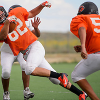 081215       Cable Hoover<br /> <br /> Xavier Hoover weaves between defenders as the Bengals run through plays during practice at Gallup High School Wednesday.
