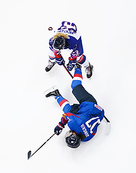 Great Britain's Chamonix Jackson (top) and Republic of Korea's Park Jong-ah battle for the puck during the Beijing 2022 Olympics Women's Pre-Qualification Round Two Group F match at the Motorpoint Arena, Nottingham.