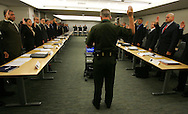 Photo by Alex Jones..US Border Patrol Assistant Chief Patrol Agent administers the oath to an incoming class of US Border Patrol recruits inside Rio Grande Valley Sector headquarters on June 14.  The class will then head to the Border Patrol Academy in Artesia, New Mexico for intensive training, and statistically only 66% will graduate and receive a post along the US Border.