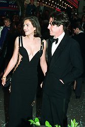 "Actor Hugh Grant arrives with actress girlfriend Elizabeth Hurley for the charity premiere of ""Four Weddings and a Funeral"" in which he stars."
