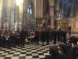 A Metropolitan Police superintendent addresses the crowd from the pulpit at Westminster Abbey to some of the hundreds of people that was evacuated from Parliament during the terrorist attack.