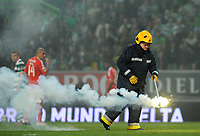 20120409: LISBON, PORTUGAL -Portuguese Liga Zon Sagres 2011/2012 - Sporting CP vs SL Benfica.<br /> In picture: A fireman takes away a flaming torch in the game Sporting VS Benfica at the Alvalade Stadium in Lisbon.<br /> PHOTO: Alvaro Isidoro/CITYFILES