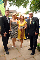 Left to right, GEORGE PISKOV jnr, TATIANA PISKOV, LIZ BREWER and CHRIS WEBER at the 20th annual House of Lords v House of Commons Tug of War in aid of Macmillan Cancer Support held on Abingdon Green, Westminster, London on 13th June 2007.<br />
