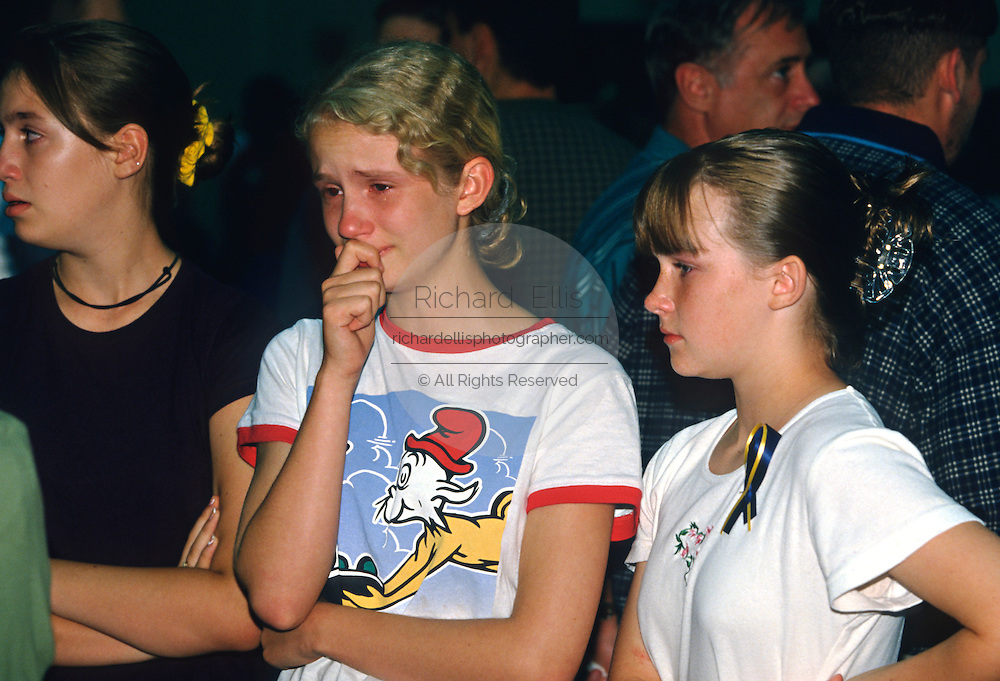 Students mourn their friends killed aboard TWA Airlines Flight 800 at a memorial service July 18, 1996 in Montoursville, PA. TWA Flight 800 exploded off East Moriches, NY with the loss of 230 lives including 21 students from the town.