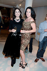 Left to right, CHARLOTTE HAYES-JONES and AMY MOLYNEAUX at the Macmillan De'Longhi Art Auction 2013 held at the Royal College of Art, London on 23rd September 2013.