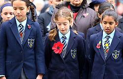 School children observe a two minute silence during the Western Front Association's annual service of remembrance at the Cenotaph, Whitehall, London.