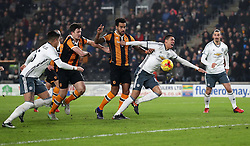 Manchester United's Chris Smalling goes down in the box under a challenge from Hull City's Tom Huddlestone during the EFL Cup Semi Final, Second Leg match at the KCOM Stadium, Hull.