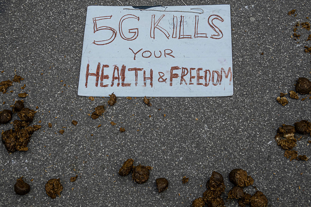 """5G, horse manure - A so called 'Mass' Gathering takes place in Hyde Park as a small group of protestors say no to the """"coronavirus bill"""" and no to the """"unlawful lockdown"""", as they fear for their freedom during the coronavirus pandemic. The protest was outnumbered by police and journalists and attracted people against vaccination, 5G, Bill Gates, paedophiles, tracking and many other things. The 'lockdown' continues for the Coronavirus (Covid 19) outbreak in London."""