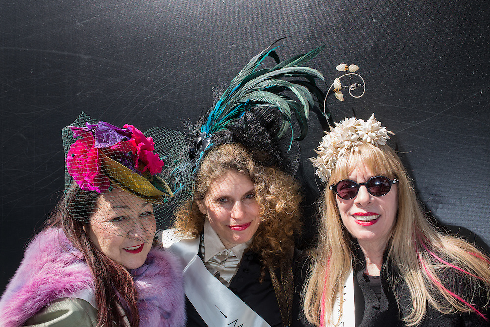 New York, NY, USA-27 March 2016. Three members of the Milliners Guild pose on Fifth Avenue  in the annual Easter Bonnet Parade and Festival. From left to right: Ellen Christine, Lisa Schaub, and Linda Ashton.