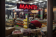 A local shop in the old market bazaar, selling the locally produced Manti and Pastirma, both from Kayseri, Turkey.