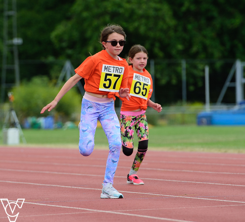 Event: 60 meters<br /> Competitors, from left: Annie Austin and Maisie Austin<br /> <br /> Metro Blind Sport's 42nd Athletics Open, held at Mile End Stadium, Tower Hamlets, London.<br /> <br /> Picture: Chris Vaughan Photography for Metro Blind Sports<br /> Date: June 16, 2018
