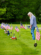23 MAY 2020 - DES MOINES, IOWA: A man stops at the grave of a military veteran in the veterans' section of Glendale Cemetery in Des Moines on Memorial Day weekend.      PHOTO BY JACK KURTZ