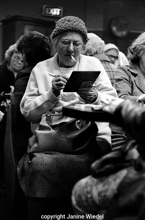 Awoman filling in Bingo card  at Mecca Bingo Hall  in Birmingham the West Midlands in the 1970s