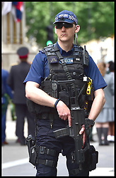 May 24, 2017 - London, London, United Kingdom - Image ©Licensed to i-Images Picture Agency. 24/05/2017. London, United Kingdom. Increased Security in London's Westminster...Armed police stand guard on London's Whitehall. Due to the Terror Alert Level being increased to critical after the recent terror attack in Manchester, security in the Capital has been stepped up with the army being deployed in key areas...Picture by Pete Maclaine / i-Images (Credit Image: © Pete Maclaine/i-Images via ZUMA Press)