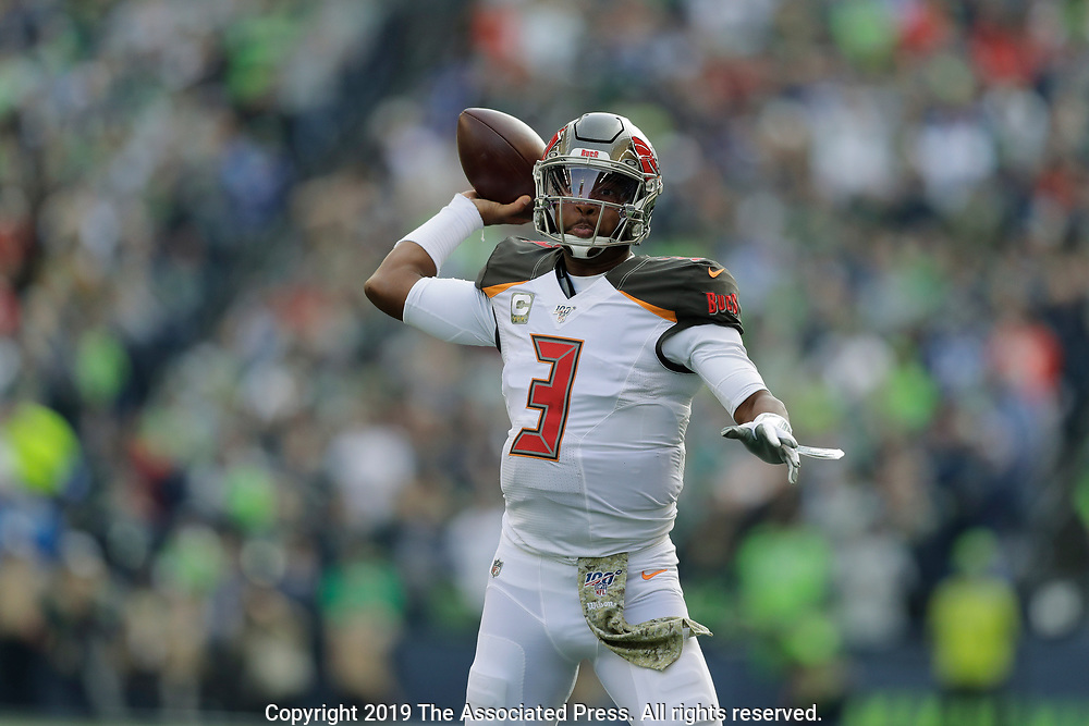 Tampa Bay Buccaneers quarterback Jameis Winston passes against the Seattle Seahawks during the first half of an NFL football game, Sunday, Nov. 3, 2019, in Seattle. (AP Photo/John Froschauer)