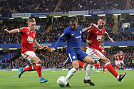Eden Hazard of Chelsea (M) takes on Ben Osborn (L) & Danny Fox of Nottingham Forest (R). Carabao Cup 3rd round match, Chelsea v Nottingham Forest at Stamford Bridge in London on Wednesday 20th September 2017.<br /> pic by Steffan Bowen, Andrew Orchard sports photography.