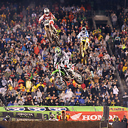 Mike Alessi, (top left), Suzuki, Joshua Hill, (top right) and Ryan Villopoto, (front), Monster Energy Kawasaki, in action on his way to victory in round 16 of the Monster Energy AMA Supercross series held at MetLife Stadium. The win clinched Villopoto his fourth consecutive 450SX Class Championship. 62,217 fans attended the event held for the first time at MetLife Stadium, New Jersey, USA. 26th April 2014. Photo Tim Clayton