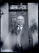 three quarter portrait of adult man standing by the front door France 1926