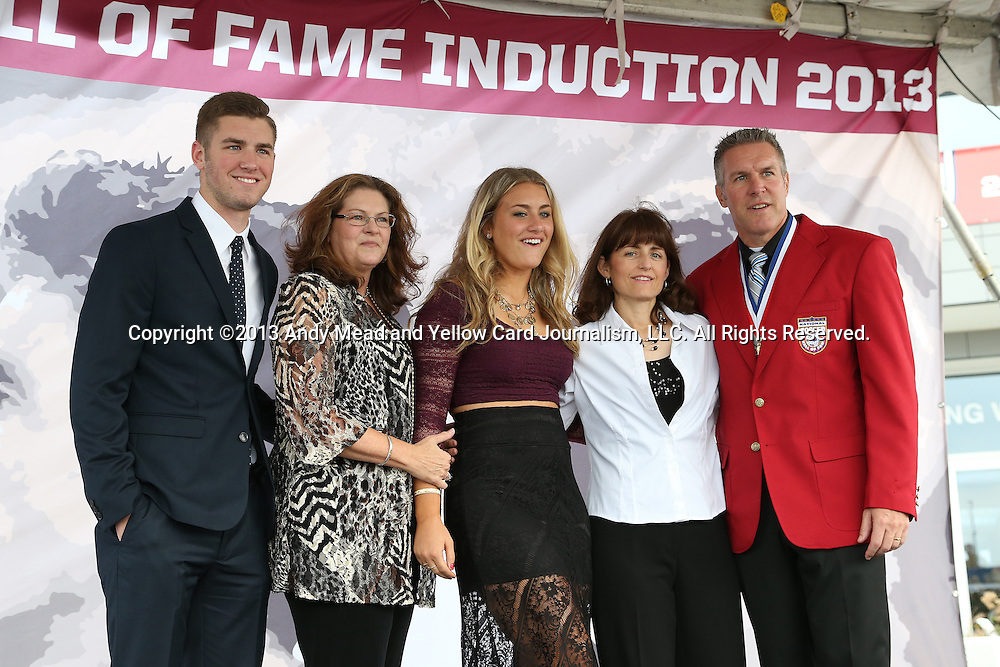 10 October 2013: 2013 inductee Peter Vermes (right) poses for photos with his family. The 2013 National Soccer Hall of Fame Induction Ceremony was held on the West Plaza outside Sporting Park in Kansas City, Kansas.