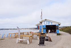 Morning yoga class inside cafe on the coastal path between Marazion and Penzance, Cornwall UK