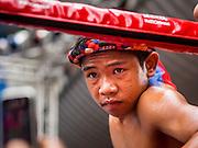 28 JULY 2013 - BANGKOK, THAILAND:  A young boxer in his corner at the ASEAN Muay Thai Championship at MBK shopping center in Bangkok.      PHOTO BY JACK KURTZ
