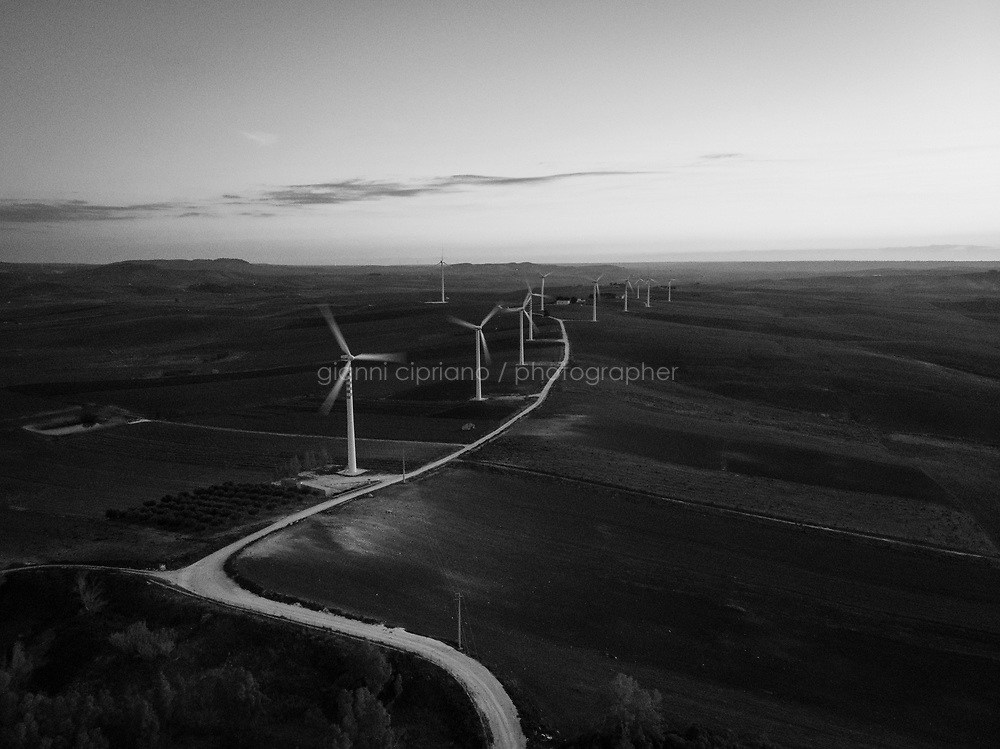 """FULGATORE, ITALY - 17 FEBRUARY 2020: A wind farm is seen here in Fulgatore, Italy, on February 17th 2020. Mafia top boss Matteo Messina Denaro's closest men have managed to infiltrate the construction of the largest wind farms in western Sicily. <br /> <br /> In 2019 Vito Nicastri, a Sicilian wind farm businessman known as the """"king of wind"""", has been sentenced to nine years in prison for bankrolling the top mafia fugitive Matteo Messina Denaro. Investigators said Nicastri, who made his name as an alternative energy entrepreneur, had invested money made from criminal activities and had """"high-level"""" contacts in the mafia and """"close ties to Matteo Messina Denaro"""". According to prosecutors, Nicastri allegedly acted as a middleman between local bosses and corrupt politicians, securing all the permits required to build and deliver hundreds of windfarm turbines to Spanish, Danish and Maltese operators, with profits finding their way back to Denaro.<br /> <br /> Described as """"the last Mohican of the old mafia"""", Matteo Messina Denaro (57) is one of the world's most wanted fugitives, who has been in hiding since 1993. He was once considered a candidate to be the Sicilian mafia's boss of bosses after the deaths of Bernardo Provenzano in 2016 and Salvatore Riina in 2017. He was born into the Denaro Family (a well-known Mafia family) in Castelvetrano in the province of Trapani, Sicily. <br /> Matteo Messina Denaro, who infamously claimed: """"I filled a cemetery all by myself"""", has apparently kept up his luxurious lifestyle, thanks to his several bankrollers who, according to prosecutors, include politicians and businessmen. Investigators have long claimed that the boss, wanted for more than 50 murders, is being shielded by powerful Freemasons in Trapani."""