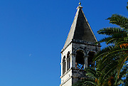 Tower of church of the Sveti Duje (Saint Dominic) Monastery, with half-moon in sky. Trogir, Croatia