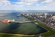 Nederland, Zeeland, Terneuzen, 09-05-2013; Zeeuws-Vlaanderen, Terneuzen. Nederland, Zeeland, Terneuzen, 09-05-2013; Zeeuws-Vlaanderen, Terneuzen. Zicht op de Westerschelde met aan de andere oever Zuid-Beveland. <br /> Site van de chemische fabriek van Dow (Dow Chemical Company) aan de Westerschelde. Afgemeerd zijn de olie en chemicaliën-tanker Sten Hidra (rood oranje) en de  Lpg-tanker BW Tokyo.<br /> De kraakinstallaties maken o.a. benzeen, ethyleen en propyleen (basischemicalien voor halffabrikaten voor verschillende kunststoffen).<br /> Zeeuws-Vlaanderen,  the south-west part of the province of Zeeland site of the chemical plant of Dow Chemical Company. This plant produces benzene, ethylene and propylene, the basis for various plastics. View on the Westerschelde. <br /> <br /> luchtfoto (toeslag op standard tarieven);<br /> aerial photo (additional fee required);<br /> copyright foto/photo Siebe Swart.