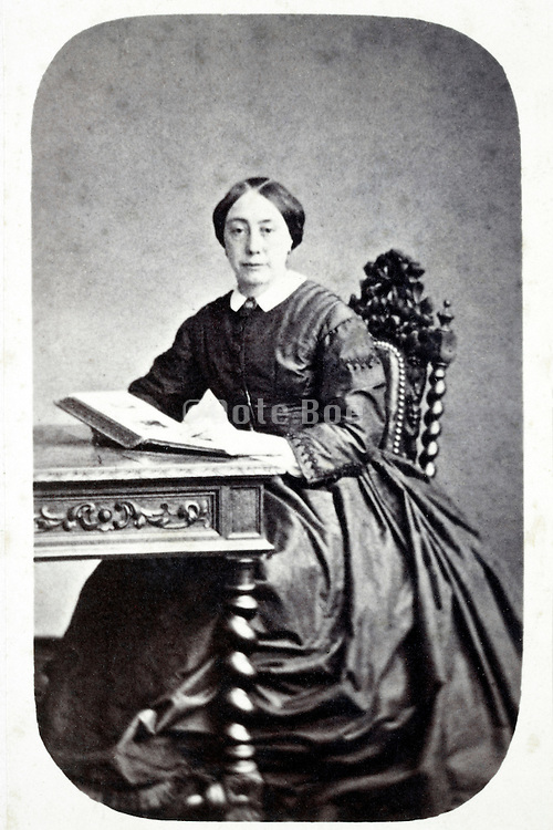 studio portrait woman sitting with book late 1800s