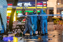 © Licensed to London News Pictures. 13/12/2020. London, UK. Forensic investigators gather evidence on St Anns Road. Police were called at approximately 19:15GMT on Sunday, 13 December to reports of a stabbing in St Anns Road, Harrow. Officers and London Ambulance Service attended. <br /> A man – believed aged in his 20s – was found suffering stab injuries; despite the efforts of the emergency services he was pronounced dead at the scene. Two further males – both believed aged in their late teens – also suffered stab injuries. Photo credit: Peter Manning/LNP