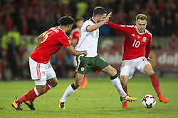 October 9, 2017 - Cardiff City, Walles, United Kingdom - Robbie Brady of Ireland fights with Ashley Williams and Aaron Ramsey of Wales during the FIFA World Cup 2018 Qualifying Round Group D match between Wales and Republic of Ireland at Cardiff City Stadium in Cardiff, Wales, United Kingdom on October 9, 2017  (Credit Image: © Andrew Surma/NurPhoto via ZUMA Press)