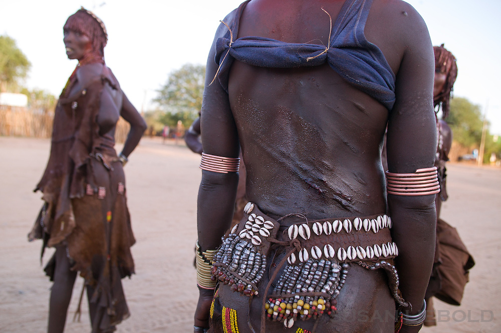 Woman proudly shows her marks from the whipping she received after her brother jumped the bull, a tradition in southern Ethiopia among the Hamer people.