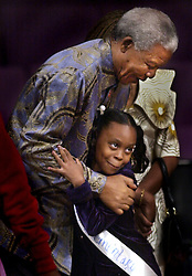Nov. 22, 2000 - Memphis, Tennessee, U.S. - NELSON MANDELA hugs LAKEYTRA ADDISON , a 4th grader from Cummings Elementery School, one of the children from 150 schools who presented books, bookmarks and money to the Nelson Mandela Children's Fund at the Freedom Award Public Forum Wednesday at the Temple of Deliverance Church of God in Christ. Mandela was in Memphis to receive the National Civil Rights Museum's International Freedom Award. (Credit Image: © A.J. Wolfe/The Commercial Appeal/ZUMApress.com)