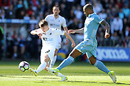 Tom Carroll of Swansea city has a shot at goal. Premier league match, Swansea city v Stoke City at the Liberty Stadium in Swansea, South Wales on Saturday 22nd April 2017.<br /> pic by Andrew Orchard, Andrew Orchard sports photography.